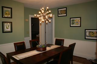 Photo of Classy Modern Dining Room with Olive Walls