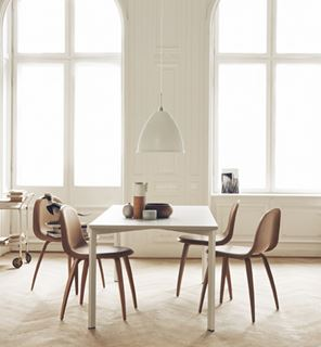 Photo of Clean Modern Dining Area with Wooden Chairs