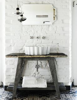 Photo of Custom Rustic Style Sink with Modern Trappings