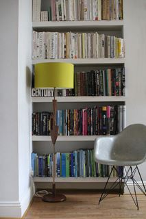 Photo of Design Bookcase with Thin Base Eiffel Chair