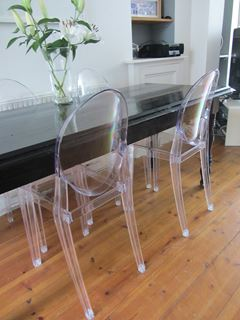 Photo of Dining Room with Acrylic Ghost Chairs