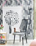 DIY Paper Cutout Wall Hanging in Contemporary Living Room