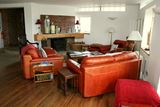 Eclectic Living Room with Orange Leather Sofa Set