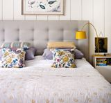 King Size Bed with Yellow Reading Light