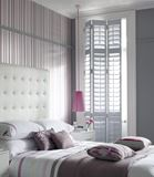 Lovely Modern Bedroom Featuring Leather Tufting and Pink Accent Detailing