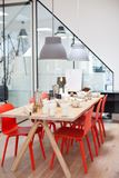 Modern Dining Table with Orange Chairs