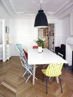 Photo of Modernized Traditional Dining Room with Mismatched Chairs