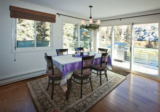 Natural Lit Ski Resort Dining Room with Scenic View