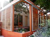 Shaded Patio in Home Built Around Three Living Trees