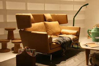 Photo of Tan Leather Loveseat with Enclosed Headrests