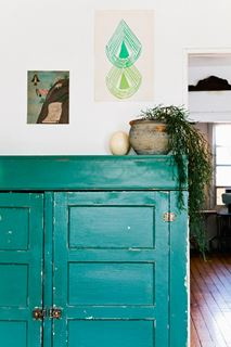 Photo of Teal Painted Storage Cabinet with Complementary Decor