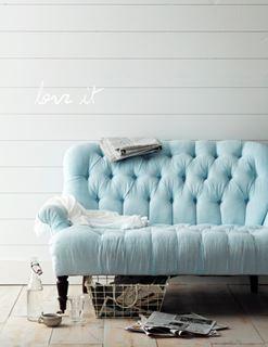 Photo of Tufted Pastel Aqua Loveseat on Tiled Floor
