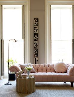 Photo of Tufted Pastel Pink Sofa in Living Room