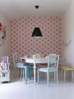 Photo of Turquoise Tolix Stool in Cute French Style Dining Area