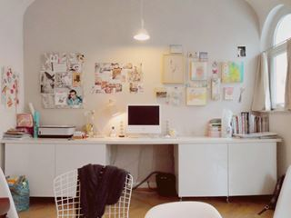 Photo of Wall Spanning Home Office Desk with Mood Board